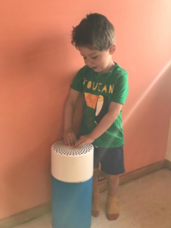blue air purifier review little boy pressing on button